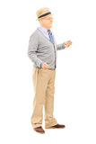 Full length portrait of senior man standing. Isolated on white background Royalty Free Stock Photography