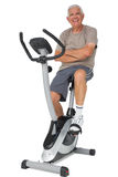 Full length portrait of a senior man on stationary bike Royalty Free Stock Images