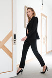 Full length portrait of sensual woman in suit and bra Royalty Free Stock Photo
