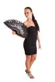Full-length portrait of sexy young woman in black. Dress with fan Royalty Free Stock Image