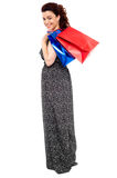 Full length portrait of shopaholic woman Royalty Free Stock Image