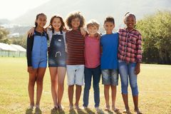 Full length portrait of six pre-teen friends in a park Stock Image