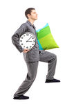 Full length portrait of a sleepwalker with a pillow and a clock Royalty Free Stock Photos