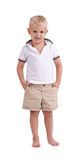 A smiling boy standing isolated on a white background. A cute kid in a summer clothes. Childhood concept. Royalty Free Stock Photo