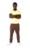 Full length portrait smiling african guy. Standing with arms crossed stock photography