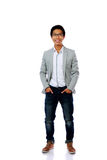 Full length portrait of smiling asian man Royalty Free Stock Images