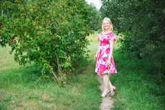 Full length portrait of smiling blond woman Royalty Free Stock Photo