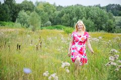 Full length portrait of smiling blond woman Royalty Free Stock Image