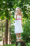 Full length portrait of smiling blonde girl with Royalty Free Stock Photography