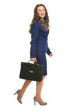 Full length portrait of smiling business woman with briefcase go Stock Images
