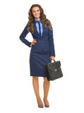 Full length portrait of smiling business woman with briefcase Stock Photo