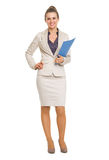 Full length portrait of smiling business woman with folder Stock Photo