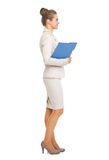 Full length portrait of smiling business woman with folder Stock Photography
