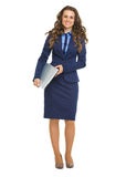 Full length portrait of smiling business woman with laptop Royalty Free Stock Photos