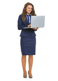 Full length portrait of smiling business woman with laptop Royalty Free Stock Photo