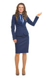 Full length portrait of smiling business woman showing something Royalty Free Stock Photo