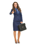 Full length portrait of smiling business woman showing thumbs up Royalty Free Stock Photo