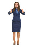 Full length portrait of smiling business woman showing thumbs up Royalty Free Stock Images