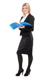 Full length portrait of a smiling businesswoman. Holding a document isolated on white background royalty free stock image
