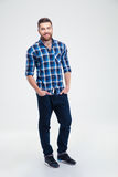 Full length portrait of a smiling casual man stock photography