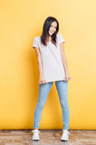 Full length portrait of a smiling casual woman Stock Images