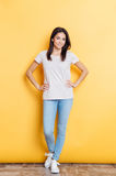 Full length portrait of a smiling casual woman Stock Image