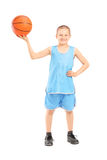 Full length portrait of a smiling child holding a basketball. Isolated on white background Royalty Free Stock Photos