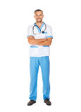 Full length portrait of smiling confident doctor with arms cross. Ed isolated on white background Stock Image