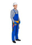 Full length portrait of smiling construction worker in uniform a. Nd tool belt isolated on white background Stock Images