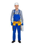 Full length portrait of smiling construction worker in uniform w. Ith toolbox isolated on white background Stock Images