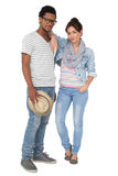 Full length portrait of a smiling cool couple royalty free stock images