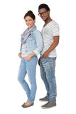 Full length portrait of a smiling cool couple Stock Photos