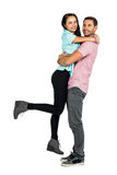 Full length of portrait of smiling couple hugging. On white screen Royalty Free Stock Images