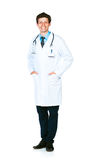 Full length portrait of the smiling doctor on a white Royalty Free Stock Image