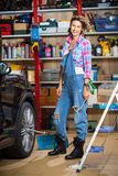 Full length portrait of a smiling female mechanic Stock Images