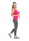 Full length portrait of smiling fitness trainer with clipboard Royalty Free Stock Photography