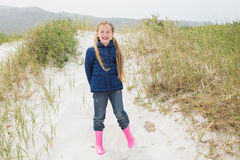 Full length portrait of a smiling girl at beach Royalty Free Stock Image