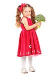Full length portrait of a smiling girl holding a broccoli Stock Images