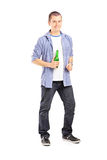 Full length portrait of a smiling guy holding a beer bottle Royalty Free Stock Images