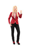 Full length portrait of a smiling and happy young woman gesturin Royalty Free Stock Photos