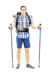 Full length portrait of a smiling hiker with backpack and hiking Royalty Free Stock Photos