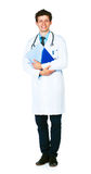 Full length portrait of a smiling male doctor holding a notepad Royalty Free Stock Images