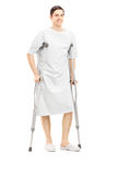 Full length portrait of a smiling male patient in hospital gown Stock Images