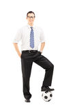 Full length portrait of a smiling man with a soccer ball Royalty Free Stock Photos