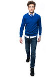 Full length portrait of a smiling man walking Royalty Free Stock Photo