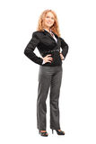 Full length portrait of a smiling professional woman posing Royalty Free Stock Images