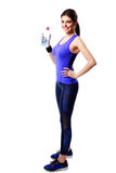 Full-length portrait of a smiling sport woman holding bottle with water Royalty Free Stock Photos