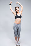 Full length portrait of a smiling sporty woman Stock Photography