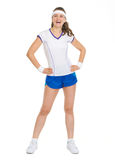 Full length portrait of smiling tennis player Stock Photography