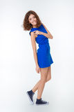 Full length portrait of a smiling woman in blue dress Stock Photo